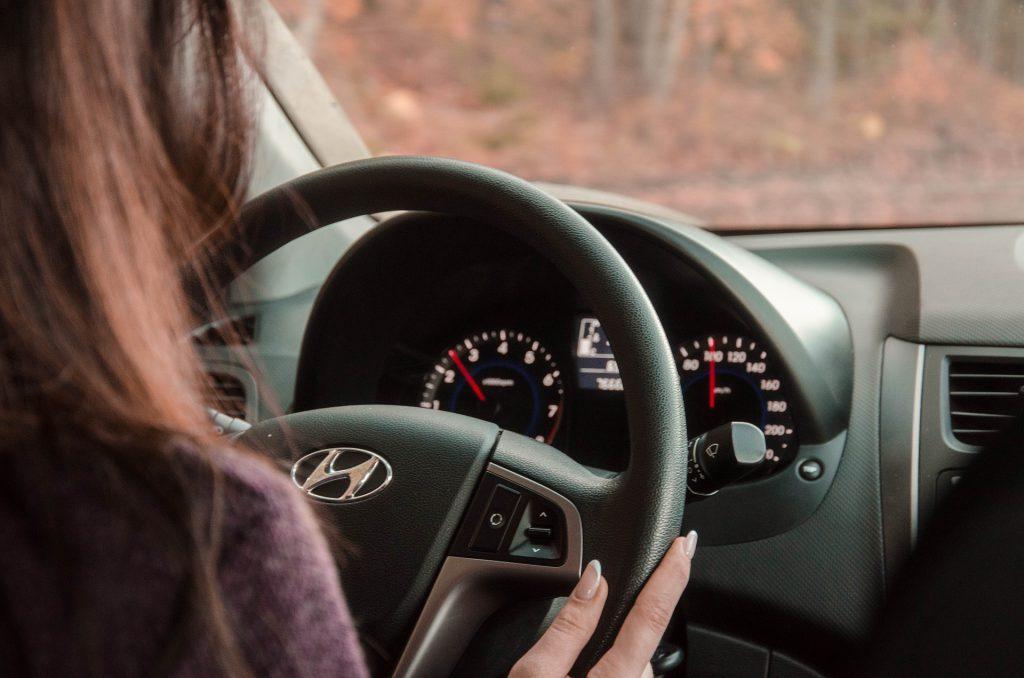 Woman driving car for ridesharing activities