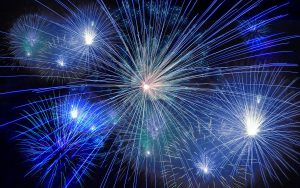 Professional fireworks display bursting in the sky. Learn safety facts to be careful with fireworks.
